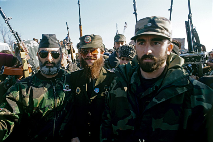 Terrorist Salman Raduyev [center], one of the leaders of armed Chechen groups, with his followers at an election rally in Grozny in January 1997. (RIA Novosti)