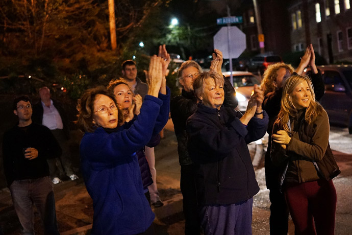 Women cheer police as they exit Franklin Street after 19-year-old bombing suspect Dzhokhar A. Tsarnaev was apprehended on April 19, 2013 in Watertown, Massachusetts. (Spencer Platt/Getty Images/AFP)