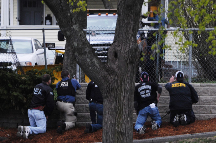 Law enforcement approach an area reportedly where a suspect is hiding on Franklin St., on April 19, 2013 in Watertown, Massachusetts. (Darren McCollester/Getty Images/AFP)