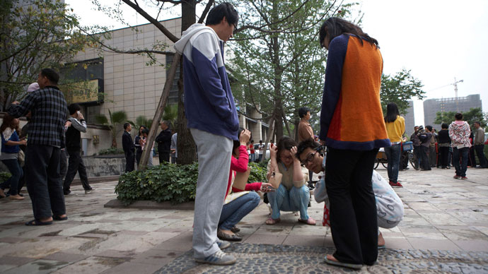 Residents leave their homes and gather in a public square after a 6.6 magnitude earthquake which struck near Ya'an city, in Chengdu, Sichuan province, April 20, 2013.(Reuters / Stringer)