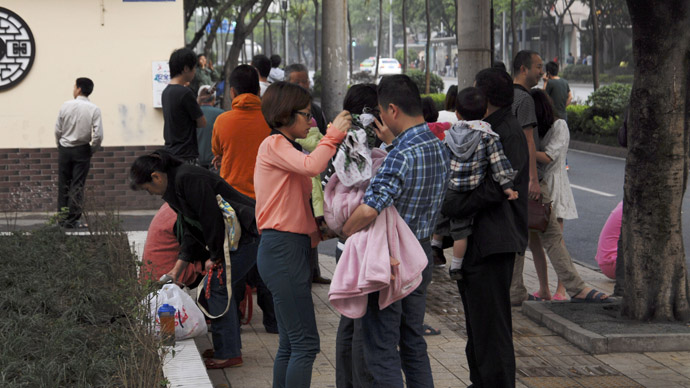 Residents gather outside their homes after a 6.6 magnitude earthquake which struck near Ya'an city, in Chengdu, Sichuan province, April 20, 2013. (Reuters)