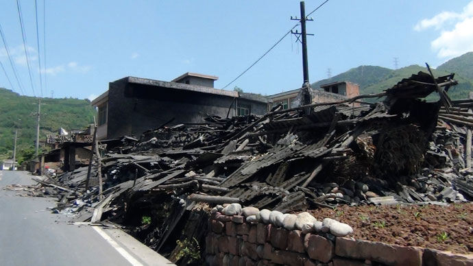 Collapsed houses are seen after an earthquake of 6.6 magnitude, on the side of a road leading from Ya'an city to Luzhou county, in Ya'an, Sichuan province April 20, 2013.(Reuters / Stringer)