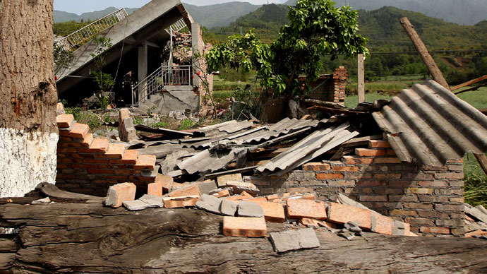 An aerial view shows houses damaged after a strong earthquake in Lushan county, Ya'an, Sichuan province, April 20, 2013. At least fifty-six people were killed and more than 500 others injured in the earthquake, according to Xinhua News Agency.(Reuters / China Daily)