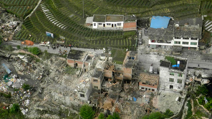 An aerial view shows houses damaged after a strong earthquake in Lushan county, Ya'an, Sichuan province, April 20, 2013.(Reuters / China Daily)