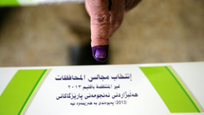 An internally displaced Iraqi shows his ink-stained finger indicating he cast a ballot at a polling station in the northern Iraqi Kurdish city of Arbil, on April 20, 2013.(AFP Photo / Ahmad Al-Rubaye)