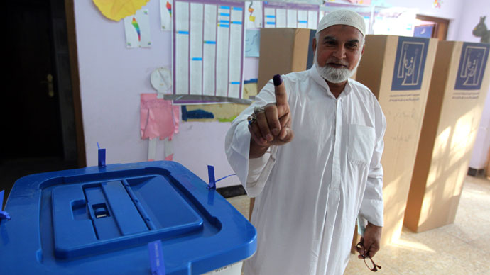 An Iraqi man shows his ink-stained finger indicating he cast a ballot at a polling station during provincial elections on April 20, 2013 in Baghdad.(AFP Photo / Ahmad Al-Rubaye)