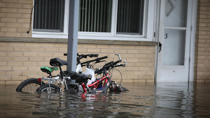 Bicycles sit in floodwater outside an apartment building April 19, 2013 in Des Plaines, Illinois.(AFP Photo / Scott Olson)