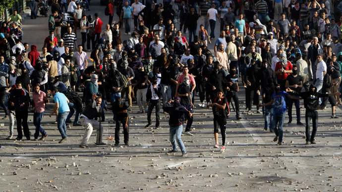 Anti-government protesters throw stones at Muslim Brotherhood members during clashes near Cairo's Tahrir Square April 19, 2013.(Reuters / Mohamed Abd El Ghany)