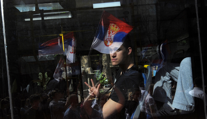 A man in a bus gestures during a protest on April 21, 2013, in Belgrade. Serbia (AFP Photo / Alexa Stankovic)