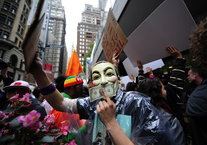 Occupy Wall Street members stage a protest march near Wall Street in New York, on October 12, 2011. (AFP Photo / Emmanuel Dunand)