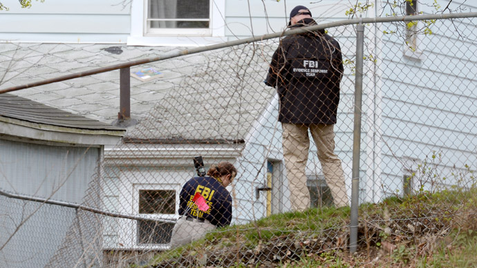 FBI investigators search the shooting scene near the boat where bombing suspect was hiding from police on Franklin Street on April 20, 2013 in Watertown, Massachusetts. (Kevork Djansezian/Getty Images/AFP)