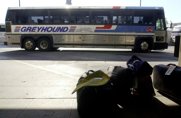 An empty Greyhound bus pulls into the Greyhound Bus Terminal. (AFP Photo / Jeff Kowalsky)