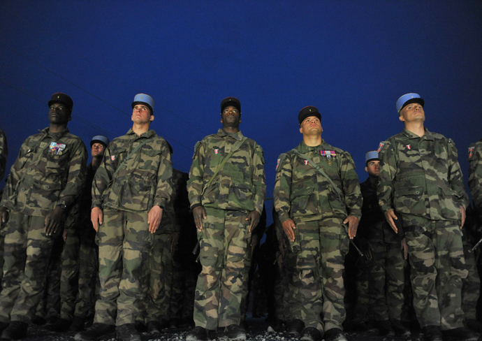 French soldiers with the NATO-led International Security Assistance Force (ISAF) stand during a departure ceremony at the French base in Surobi district in Kabul province on March 18, 2012 (AFP Photo / Shah Marai)