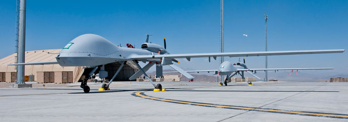 Two freshly assembled Grey Eagle unmanned aerial vehicles sit on the tarmac at Forward Operating Base Shan in Logar Province, Afghanistan.(AFP Photo / Sgt. Ken Scar)