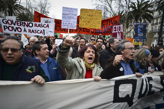 People wave placards as they protest during a demonstration in downtown Lisbon on March 2, 2013. (AFP Photo)