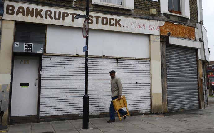 A man walks past a closed down shop in east London, January 25, 2013. (Reuters)