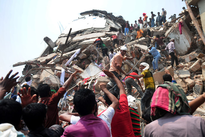 Bangladeshi volunteers and rescue workers assist in rescue operations 48 hours after an eight-storey building collapsed in Savar, on the outskirts of Dhaka, on April 26, 2013. (AFP Photo/Munir Uz Zaman)
