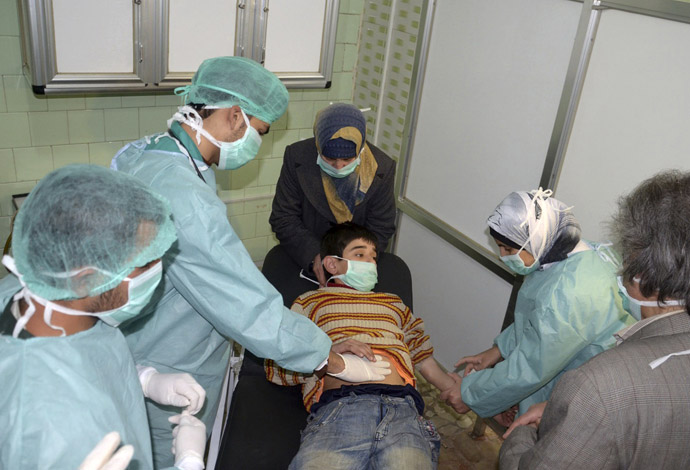 A boy, affected in what the government said was a chemical weapons attack, is treated at a hospital in the Syrian city of Aleppo March 19, 2013. (Reuters/George Ourfalian)