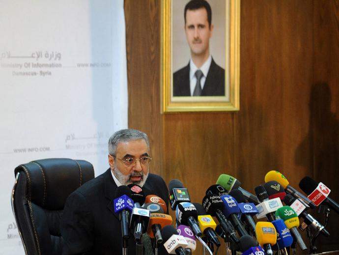 Syrian Information Minister Omran al-Zouabi. (AFP Photo / Louai Beshara)