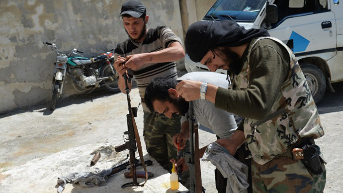 Members of the Al-Ezz bin Abdul Salam brigade clean their weapons during a training session at an undisclosed location near the al-Turkman mountains, in Syria's northern Latakia province, on April 25, 2013. (AFP  Photo / Miguel Medina)
