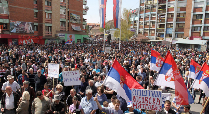 Kosovo Serbs wave flags during a protest against the accord on the normalisation of relations between Serbia and Kosovo, in the ethnically divided town of Mitrovica on April 22, 2013 (AFP Photo / Sasa Djordjevic)