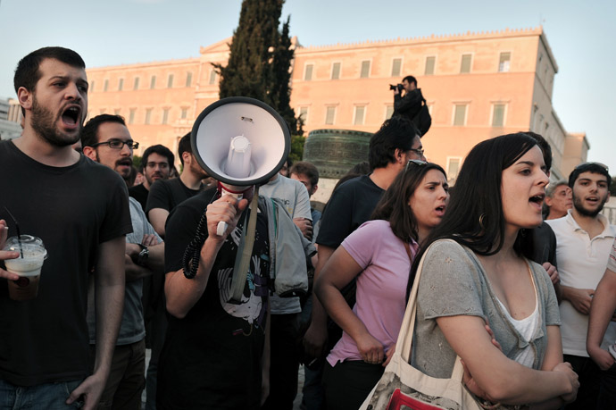 Protesters shout as they demonstrate in front of the parliament in Athens on April 28, 2013. (AFP Photo/Louisa Gouliamaki)