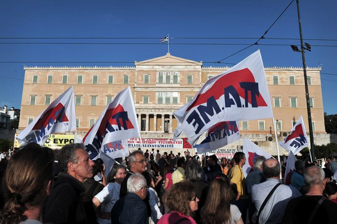 Protesters hold flags as they gather in front of the parliament in Athens on April 28, 2013. (AFP Photo/Louisa Gouliamaki)