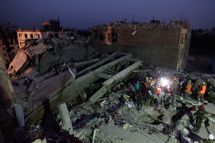 Rescue workers attempt to rescue garment workers from the rubble of the collapsed Rana Plaza building, in Savar, 30 km (19 miles) outside Dhaka April 28, 2013 (Reuters / Andrew Biraj)