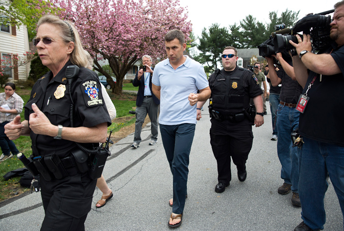 Ruslan Tsarni (C) is escorted by police as he walks to his home after speaking with a neighbor in Montgomery Village, Maryland April 19, 2013 (Reuters / Joshua Roberts)