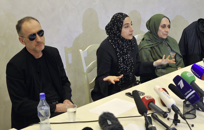 Zubeidat Tsarnaeva (C) and Anzor Tsarnaev, the parents of Tamerlan and Djokhar Tsarnaev suspected of setting up the Boston explosions, are seen at a press conference in Makhachkala (Reuters / Stringer)