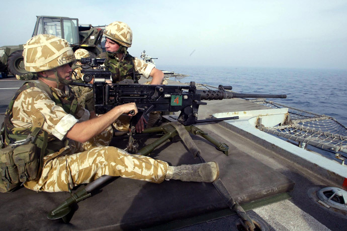 Royal Marines practice their drill using a Browning heavy machine gun on the deck of HMS Ocean as it travels through the Persian Gulf. (AFP Photo)