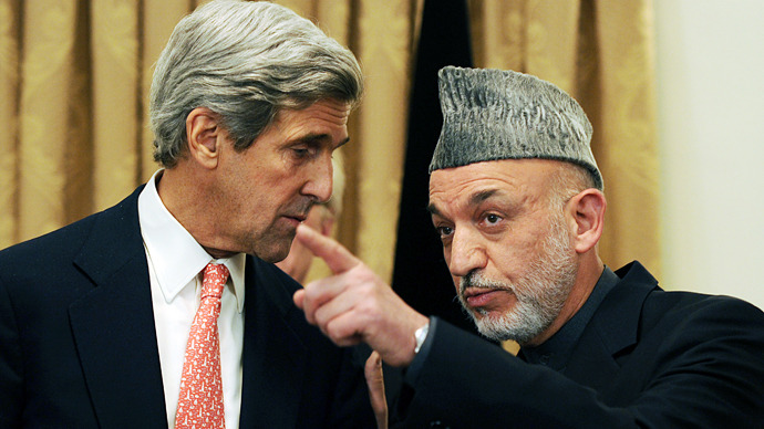 US Secretary of State John Kerry meets with Afghan President Hamid Karzai.