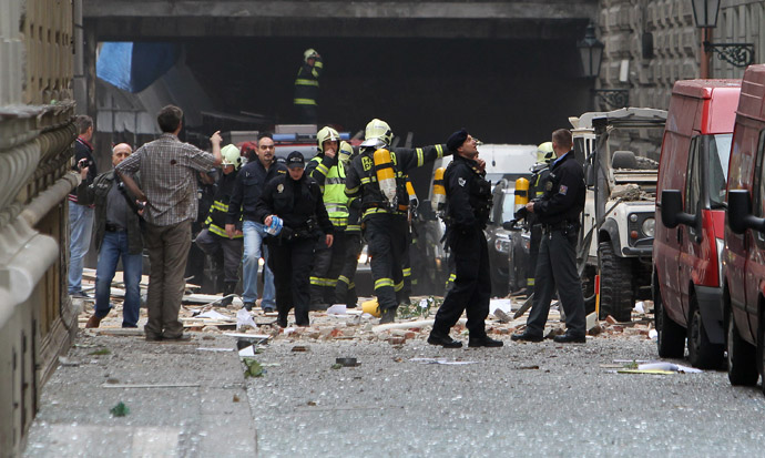 Firefighters and police officers search an area after an explosion in Prague April 29, 2013. (Reuters/David W Cerny)
