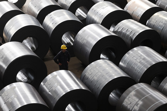 An employee works at a steel factory that exports to Europe and America in Jiaxing, Zhejiang province, February 28, 2013. (Reuters)