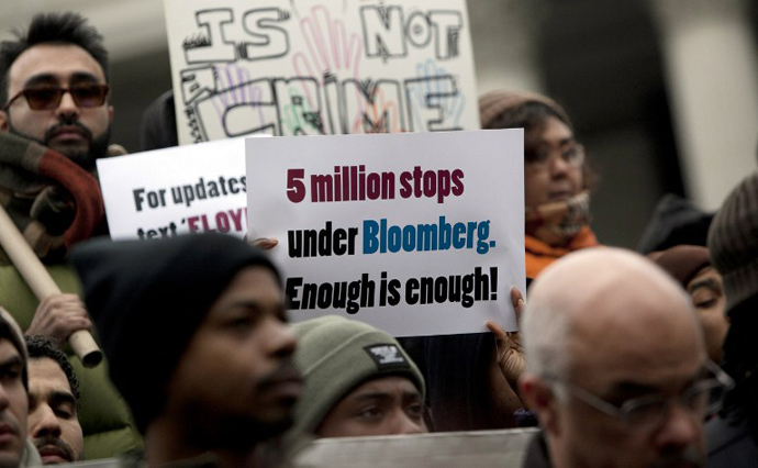 """A man holds a sign during a demonstration against the city's """"stop and frisk"""" searches in lower Manhattan near Federal Court March 18, 2013 in New York City. (AFP Photo / Getty Images / Allison Joyce)"""