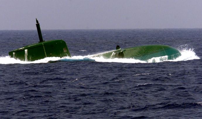 Israel's new Dolphin-class submarine surfaces in the Mediterrannean Sea near Haifa (Reuters)