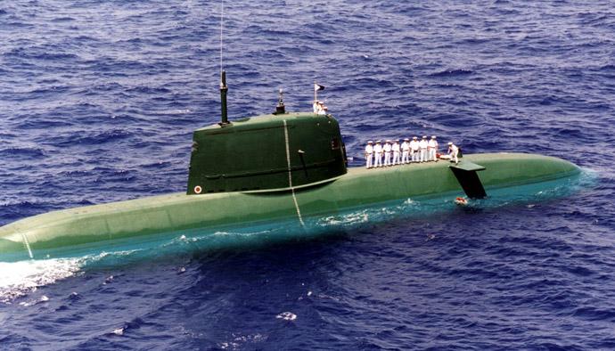 Israeli Seamen atop a new Dolphin-class submarine lay 69 wreaths in Mediterrannean Sea between Cyprus and Crete (Reuters)