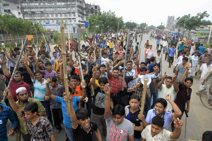 Garment workers shout slogans as they block a street during a protest to demand capital punishment for those responsible for the collapse of the Rana Plaza building in Savar, outside Dhaka April 30, 2013. (Reuters/Sajid Hossain)