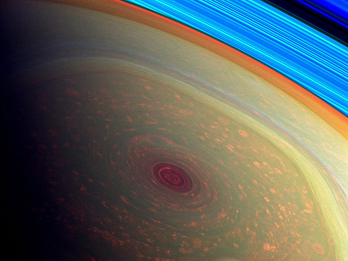 This spectacular, vertigo inducing, false-color image from NASA's Cassini mission highlights the storms at Saturn's north pole. (NASA/JPL-Caltech/SSI)