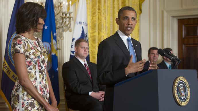 US President Barack Obama speaks alongside First Lady Michelle Obama in Washington on April 30, 2013 (AFP Photo / Saul Loeb)