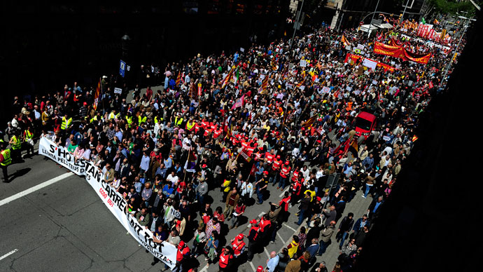 Demonstrators take part a Labour Day march against the Spanish government's austerity policies in the centre of Barcelona on May 1, 2013.(AFP Photo / Josep Lago)
