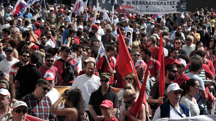 Communist-affiliated protesters and foreign workers gather at a central Athens square during a May Day rally on May 1, 2013.(AFP Photo / Louisa Gouliamaki)
