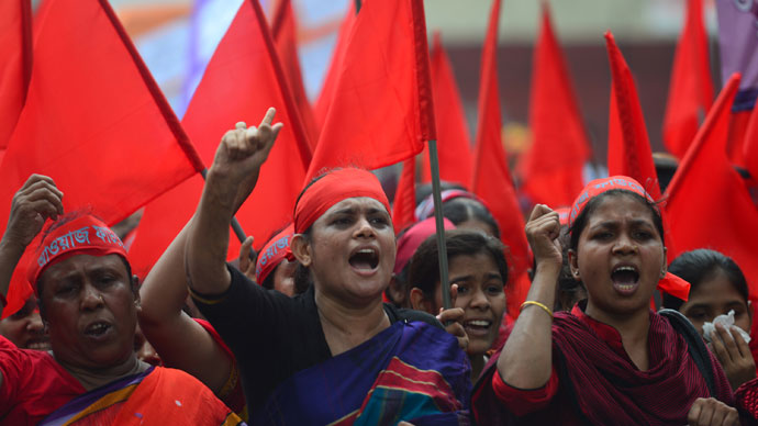 Bangladeshi activists shout slogans and wave flags during a procession to mark May Day or International Workers Day in Dhaka on May 1, 2013.(AFP Photo / Munir uz Zaman)