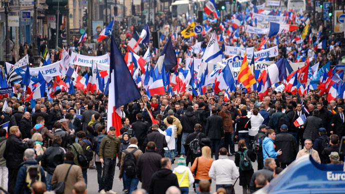 Waving French national flags, people attend French far right party Front National (FN) annual celebration of Joan of Arc on May 1, 2013 in Paris.(AFP Photo / Eric Feferberg)
