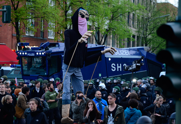 Protesters operate a giant puppet dressed a a demonstrant as they take part in the 'Revolutionary' May Day demonstration on May 1, 2013 in Berlin (AFP Photo / John Macdougall)