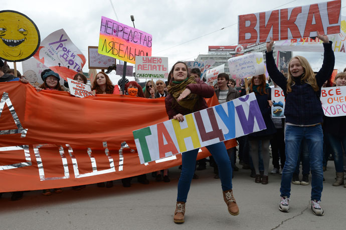 The dancing girl's sign says: 'Dance'. (RIA Novosti / Alexandr Kryazhev)