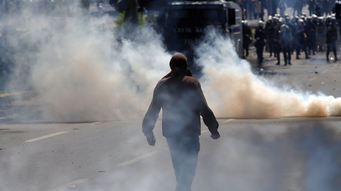 A protestor holds a stone during clashes with police at a May Day demonstration on May 1, 2013.(AFP Photo / Ozan Kose)