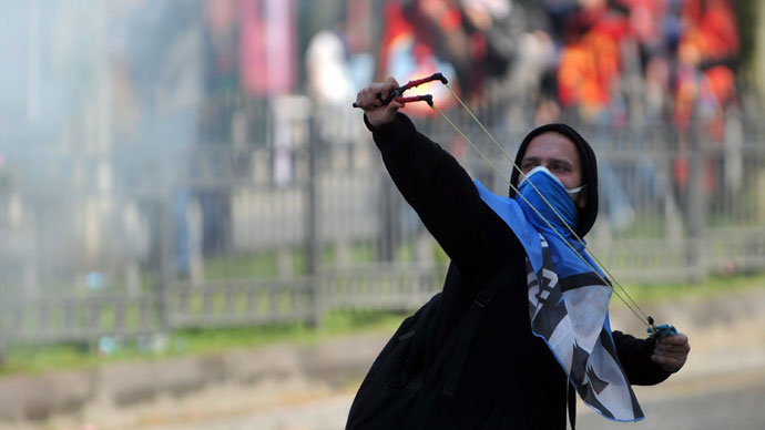A protestor uses a slingshot during clashes with police at a May Day demonstration on May 1, 2013.(AFP Photo / Ozan Kose)