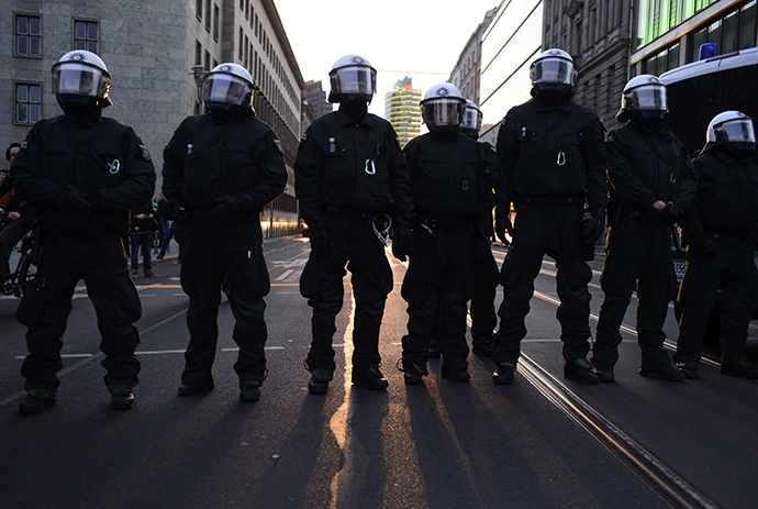Policemen and policewomen stand on a street during the 'Revolutionary' May Day demonstration on May 1, 2013 in Berlin. (AFP Photo / John Mcdougall)