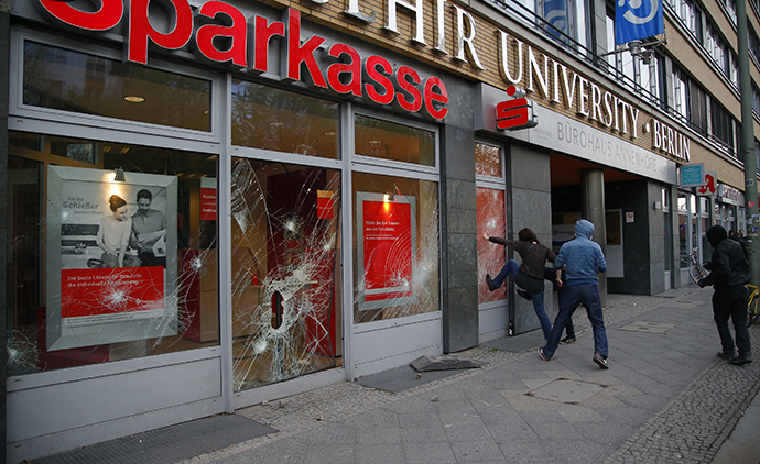 Demonstrators break windows of a savings bank during May Day protests in Berlin, May 1, 2013. (Reuters / Pawel Kopczynski)